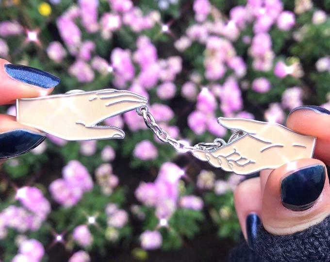 reverie-enamel-pin-of-hands