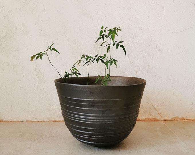 genyu-black-pottery-rotary